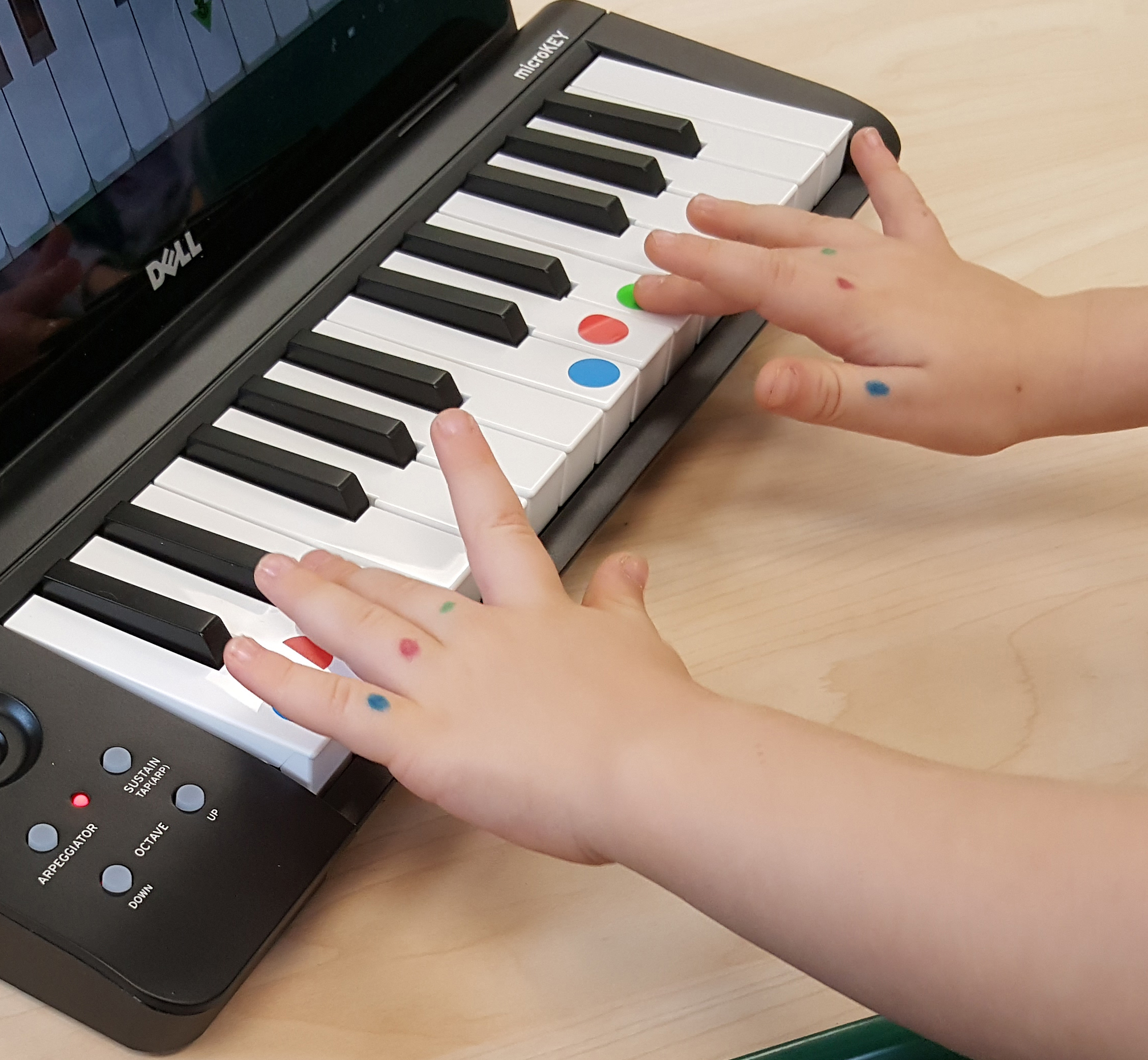 Children working with Anybody Can Play PIANO computer program.